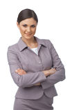 Woman With Folded Hands. Pretty young business woman with hands folded looking at you on white background Stock Image