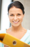 Woman with folder Royalty Free Stock Photos