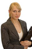 Woman with a folder. The young beautiful woman holds in hands a folder with documents Royalty Free Stock Photography