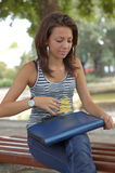Woman with folder on bench royalty free stock photography