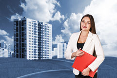 Woman with folder outdoors Stock Photo