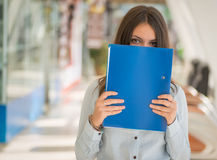 Woman with folder. Stock Image