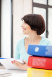 Woman with folders. Bright picture of beautiful woman with folders Royalty Free Stock Photo