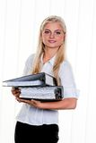 Woman with folders. Young Woman with a stack of files Royalty Free Stock Image