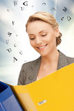 Woman with folders. Bright picture of beautiful woman with folders Stock Photos