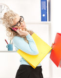 Woman with folders and cell phone Royalty Free Stock Photography