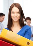 Woman with folders in office Royalty Free Stock Image