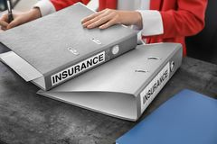 Woman with folders at table. Insurance concept Royalty Free Stock Photo