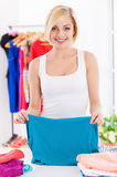 Woman folding clothes. Stock Image