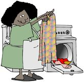Woman folding clothes Stock Photo
