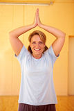 Woman folding hands in gym Royalty Free Stock Photos