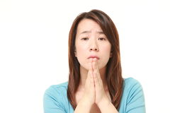 Woman folding her hands in prayer Stock Images