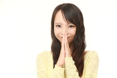 Woman folding her hands in prayer Royalty Free Stock Image