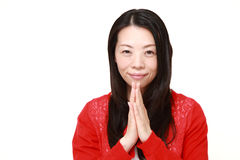 Woman folding her hands in prayer Stock Photography