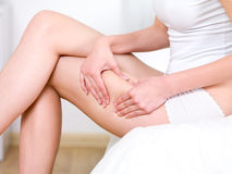 Woman folding skin on her hips Royalty Free Stock Photos