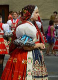 Woman in folk costume. Woman dressed in moravian folk costume during folklore festival The Moravian -Slovak Year in Kyjov 13 -16 August 2015, the oldest regional Royalty Free Stock Images