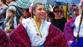 Woman folk dancer in dress of Azuay province, Ecuador. Cuenca, Ecuador - April 11, 2019: Smiling beautiful woman folk dancer in typical dress of Azuay province stock image