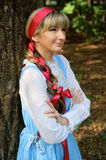 Woman in folk russian dress Stock Image