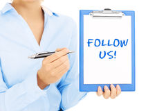 Woman with follow us sign Royalty Free Stock Images