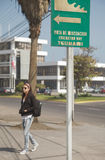 Woman following Tsunami Warning Sign in city of Iquique Chile Royalty Free Stock Image