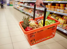 Woman with food basket at grocery or supermarket Royalty Free Stock Photo