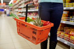 Woman with food basket at grocery or supermarket Stock Photos
