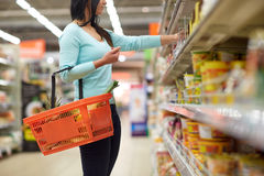 Woman with food basket at grocery or supermarket Royalty Free Stock Photos