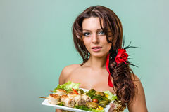 Woman with food Royalty Free Stock Photography