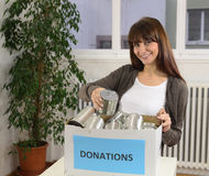 Woman with food donation box Royalty Free Stock Image