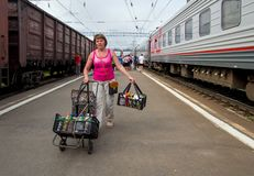 A woman with food goes on the platform of the railway station Petrozavodsk Stock Photo