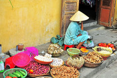 Woman at the food market in Vietnam Stock Photo