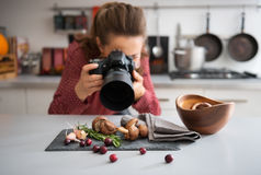 Woman food photographer taking closeup of mushrooms Stock Photography