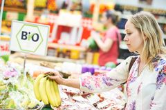Woman at food shopping in store Royalty Free Stock Photo