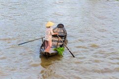 Woman and food stall boat in Nga Nam floating market, Soc Trang Stock Photos