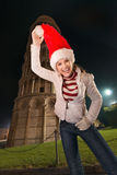 Woman fooling around with Santa hat near Leaning Tower of Pisa Stock Image