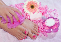Woman foot in beauty treatment. With soap and sponge Stock Photos