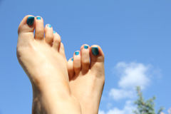 Woman foot with blue nails Royalty Free Stock Images