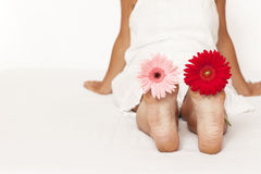 Woman foot with flowers Stock Photo