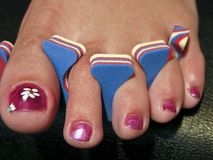 Woman Foot after a French Pedicure, USA Royalty Free Stock Images