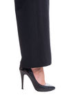 Woman foot or leg wearing high heel black leather shoe Stock Photography