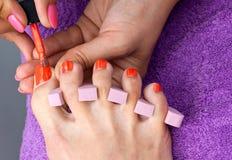 Woman foot in nail polishing Royalty Free Stock Photos