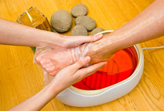 Woman foot in paraffin bath at the spa Royalty Free Stock Image