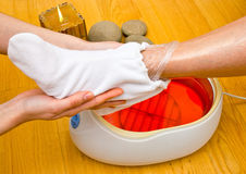 Woman foot in paraffin bath at the spa Stock Images