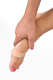 Woman foot with patch. And hand holding it Stock Images