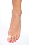 Woman foot with patch. On thumb Royalty Free Stock Image