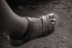 Woman foot with sandal. In black white tones Stock Photos