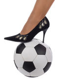 Woman foot in shoe on ball Stock Photo