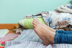 Woman Foot. Single woman foot leave on a bed Stock Photo