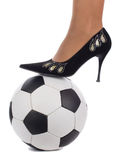 Woman foot on soccer ball Stock Photography
