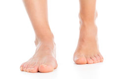 Woman foot stepping Stock Image